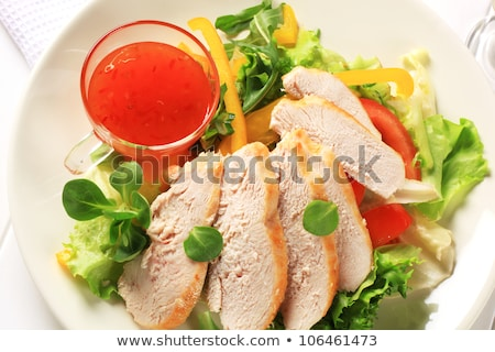 Sliced chicken breast with salad and sweet chilli sauce Stock photo © Digifoodstock