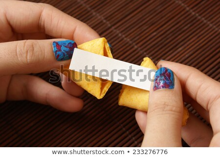 A crunchy cookie reading Stock photo © bluering