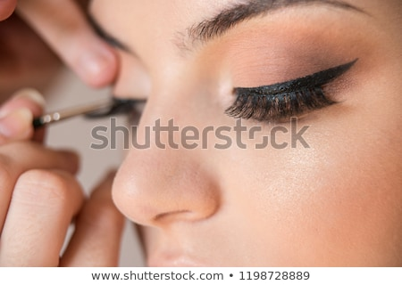 Beautiful woman during make-up cosmetics session Stock photo © Elnur