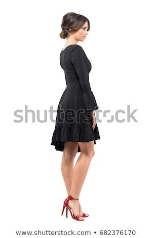 Töprengő fiatal nő fekete ruha áll másfelé néz portré Stock fotó © deandrobot