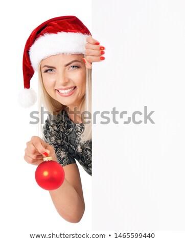 cheerful santa woman holding empty white board stock photo © konradbak