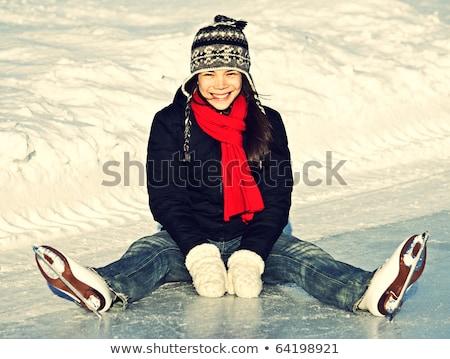 Young cheerful girl skating on the lake. Stock photo © justinb
