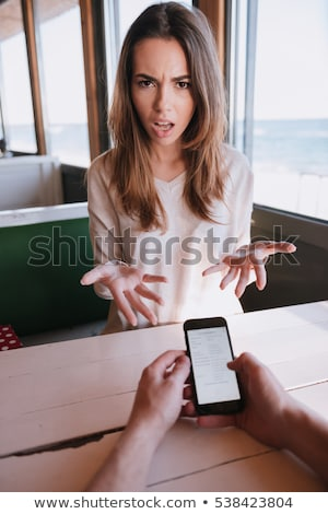 Függőleges kép elégedetlen nő asztal fürdőköpeny Stock fotó © deandrobot