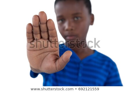 Cute boy showing his hand while ignoring Stock photo © wavebreak_media