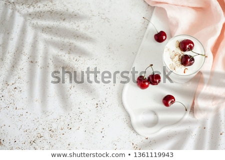 fresh cherry yogurt with oats and chia seeds delicious dessert for healthy breakfast stock photo © yelenayemchuk