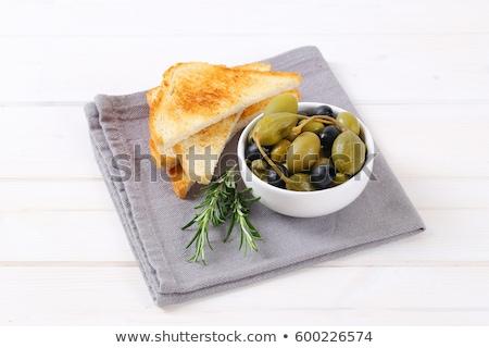 Olijven bessen toast kom geserveerd brood Stockfoto © Digifoodstock