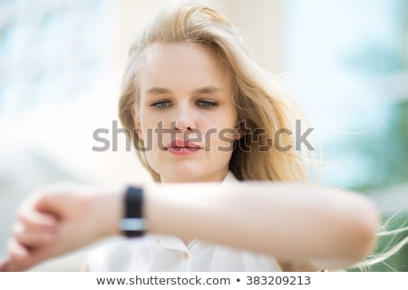 Girl wearing smart-watch on her hand  Stock photo © manaemedia