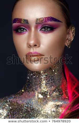 Nő csillámlás ajkak fiatal gyönyörű nő néz Stock fotó © LightFieldStudios