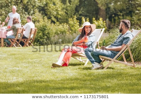 Man and woman sitting outside in garden Stock photo © IS2