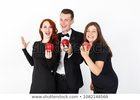 Woman smiling at viewer eating an apple Stock photo © IS2
