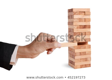 Business man puts last block on tower Stock photo © IS2