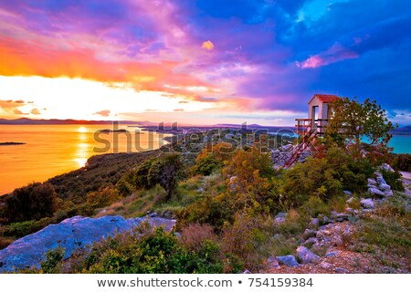 Lookout tower above Pakostane archipelago at golden sunset Stock photo © xbrchx