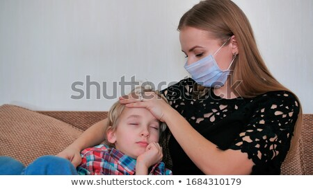 woman with bandage on mouth and phone Stock photo © studiostoks