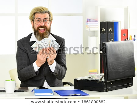 Man having illegally earned money Stock photo © ichiosea
