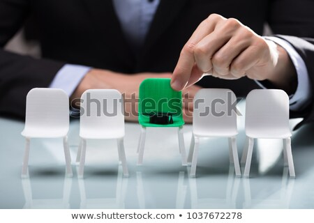 Businessperson Choosing Green Chair With Graduation Hat Stock photo © AndreyPopov