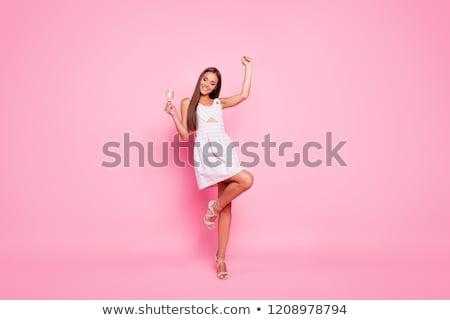 Gyönyörű lány hosszú ruha pezsgő gyönyörű szőke Stock fotó © svetography