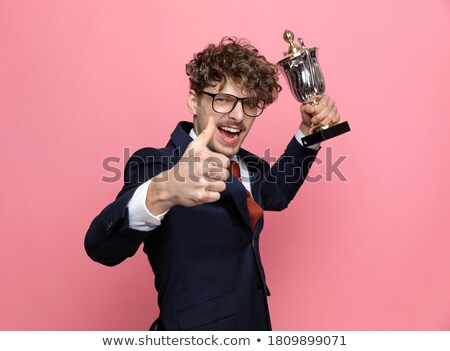 happy businessman in navy suit presenting and making ok sign Stock photo © feedough