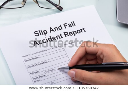 woman filling slip and fall accident report stock photo © andreypopov