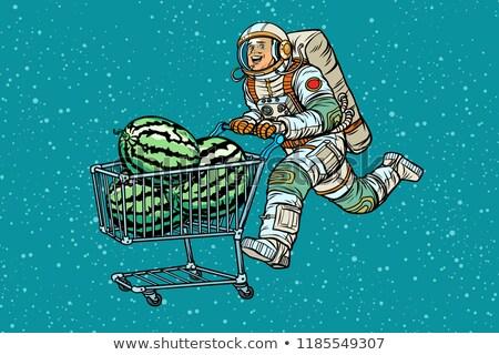 Astronaut buys watermelons. shopping cart trolley sale Stock photo © studiostoks