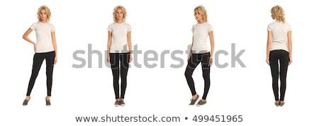 jonge · vrouw · zwarte · broek · witte · blouse · poseren · muur · sexy - stockfoto © acidgrey