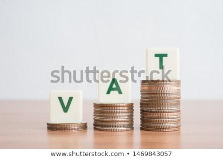ÁFA szó növekvő egymásra pakolva érmék fehér Stock fotó © AndreyPopov