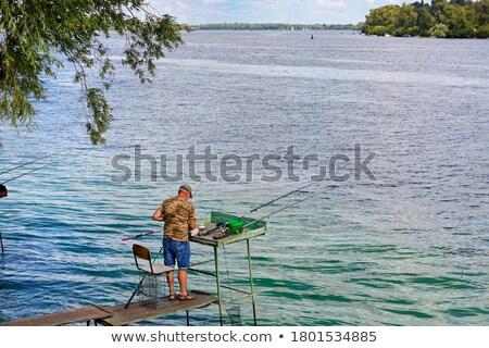 Fishermen fishing from boat, platform and bank Stock photo © robuart