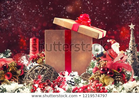 Christmas background concept. Shimmering Christmas decorations with tree, Santa Claus and candles Stock photo © alphaspirit