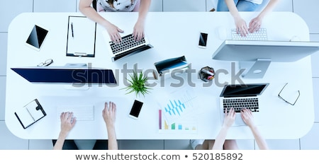 Business people connected on internet network with laptop and tablet. concept of startup company Stock photo © alphaspirit