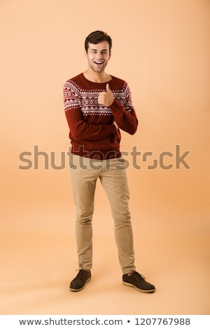Image of optimistic man 20s with bristle wearing knitted sweater Stock photo © deandrobot