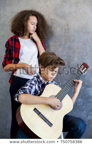 подростков мальчика играет подростка девушка прослушивании Сток-фото © boggy