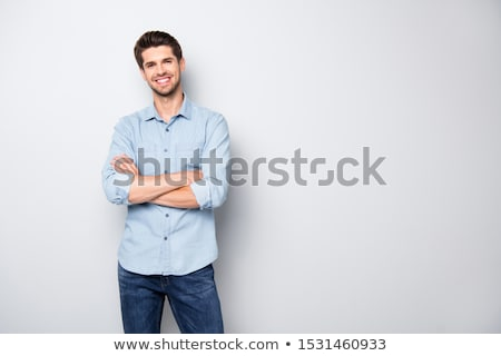portrait of a cheerful young man wearing shirt stock photo © deandrobot