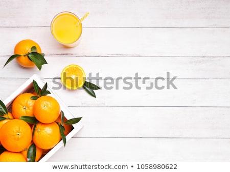 Glass jar of raw organic fresh orange juice on wood Stock photo © DenisMArt