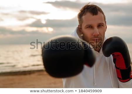 Sportok férfi boxoló kint tengerpart boxkesztyűk Stock fotó © deandrobot