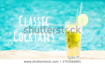 Mojito cocktail at the edge of a resort pool. Concept of luxury  Stock photo © dashapetrenko