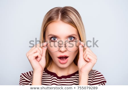 Portrait of an astonished young woman Stock photo © deandrobot