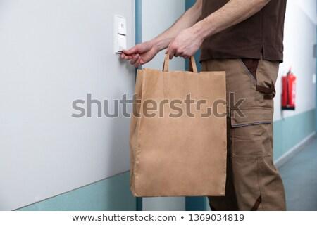 男 ドア 鐘 紙袋 手 ストックフォト © AndreyPopov
