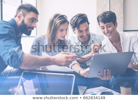 teamwork process young businessmen hands pointing at document a stock photo © freedomz