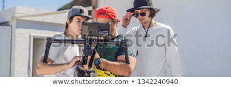 camera operator, director and dp discuss the process of a commercial video shoot BANNER, LONG FORMAT Stock photo © galitskaya