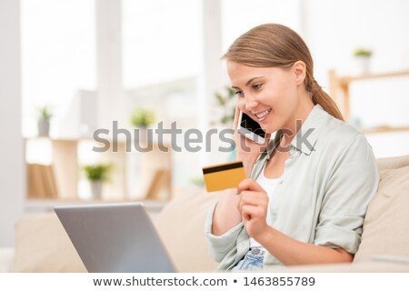 Stock photo: Contemporary girl talking to manager of online shop in front of laptop