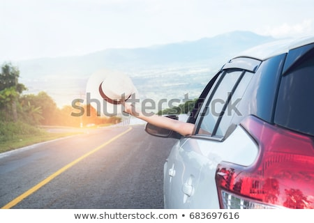 Relaxed happy traveler, Young beatiful asian gilr holding hat we Stock photo © Freedomz