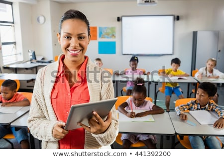 Young schoolchild computing in front of digital tablet Stock photo © pressmaster