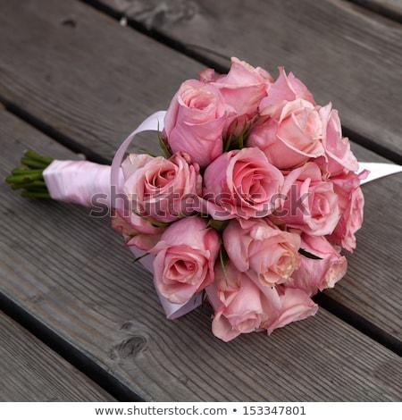 Bouquet of pink flowers lies on a wooden floor Stock photo © ElenaBatkova