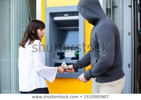 Shocked Woman Looking At Thief Stealing Her Money Stock photo © AndreyPopov