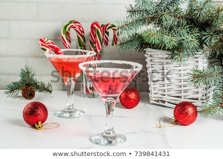 Pink peppermint martini with candy cane rim Stock photo © furmanphoto
