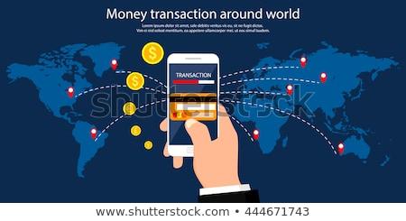 Argent transaction autour monde affaires mobiles Photo stock © benzoix