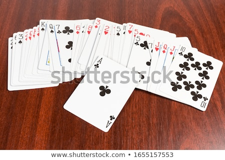 Playing cards on the table. Ace of hearts on top Stock photo © nomadsoul1