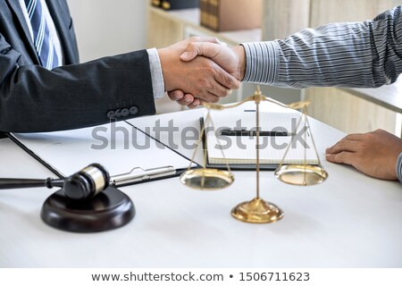 lawyer or attorneys shaking hand with client after consultation  Stock photo © snowing