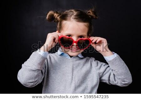 Cheerful girl with toothy smile taking off stylish sunglasses and looking at you Stock photo © pressmaster