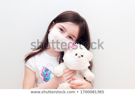 Kislány tart ölel plüssmaci maszk koronavírus Stock fotó © Illia