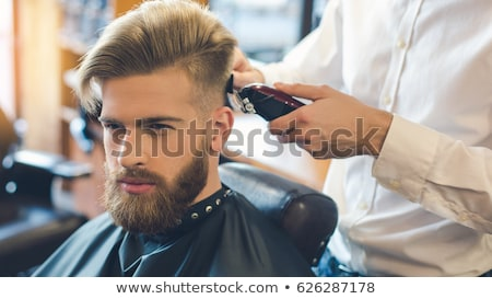 Mann Barbier Trimmer Schneiden Bart Salon Stock foto © dolgachov